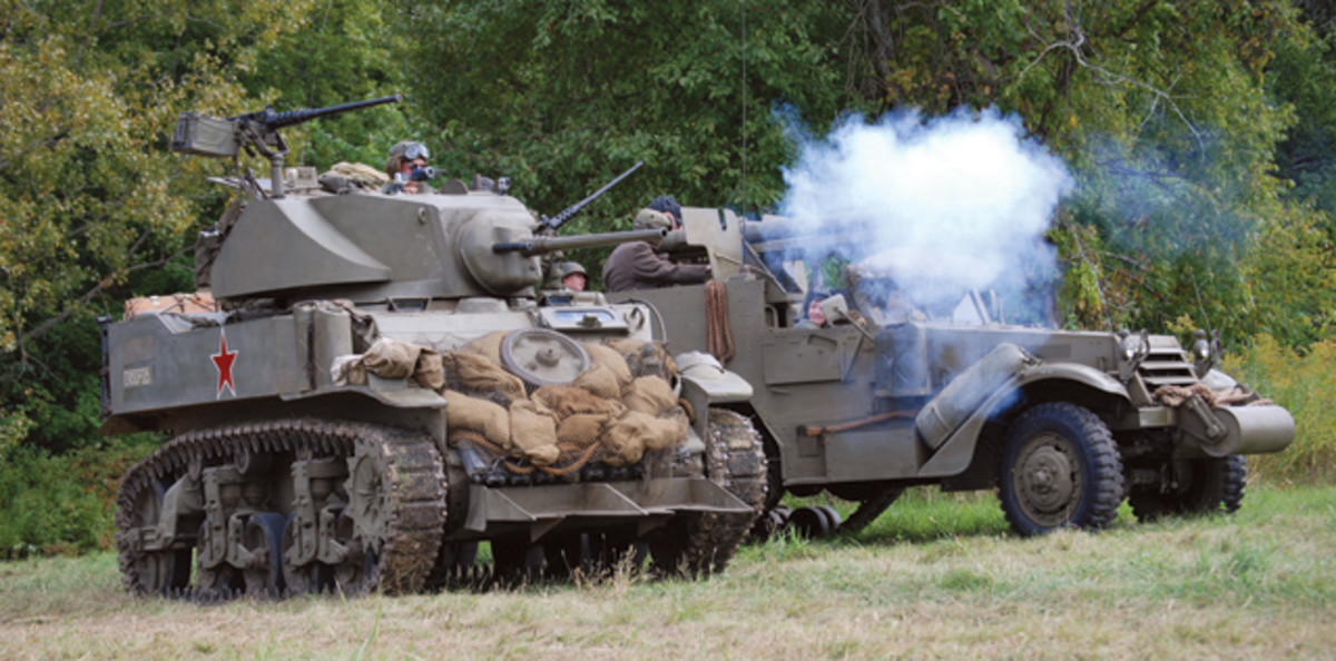 Saturday's Eastern Front battle opened with heavy maneuvering of Lend-Lease vehicles like this M5A1 light tank and M3 75mm gun motor carriage (courtesy of Roberts Armor Museum).
