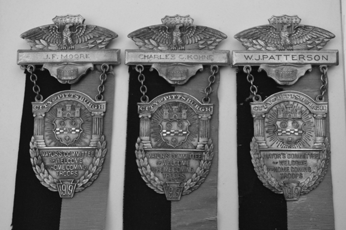 A trio of named WWI Pittsburgh Homecoming Medals provided the clues to the issue. All three of the named individuals were not soldiers who served in France, but rather, they were members of the committee involved in planning the homecoming events for the soldiers!