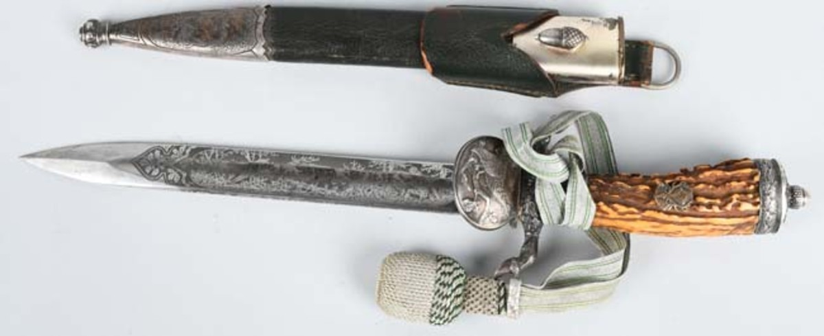 Nazi National Hunting Association dagger, triple-engraved blade with Eickhorn insignia. Sold for $3,700