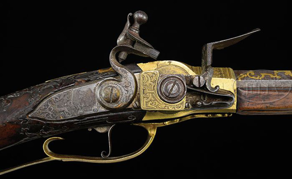 This rare and magnificent rifle was made for King Louis XV of France. This extraordinary gold and silver embellished gun was created by Sebastian Hauschka and possesses the exceedingly rare Lorenzoni repeating flintlock system. Circa 1735. At one time in his majesty's Royal Cabinet d'Arms in Paris, is impressed with inventory # 464. To own a personal gun of one of France's great kings is a once in a lifetime opportunity. In fact, the last time a gun of such high stature was sold publicly, took place over 40 years ago.