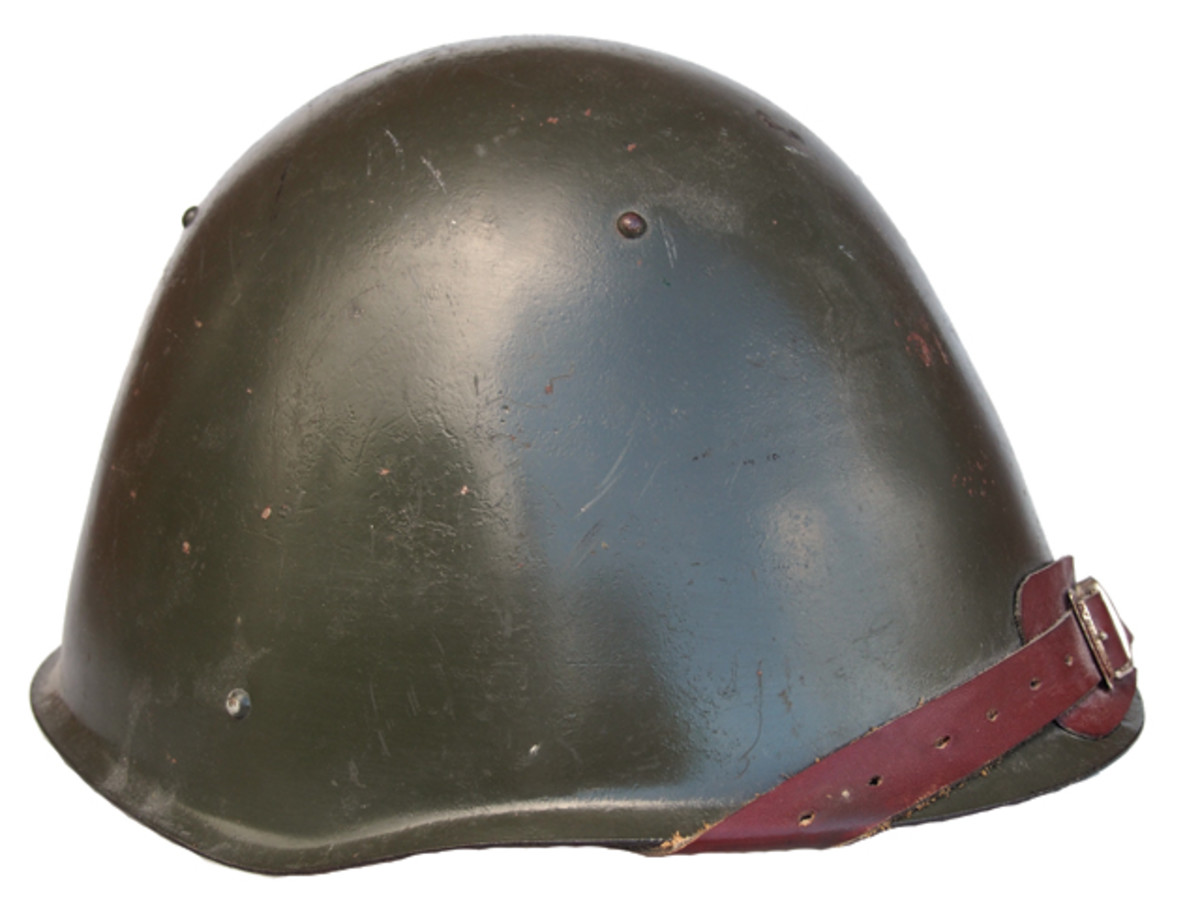 """This Soviet pattern SSh-68 """"Cone Head"""" steel helmet was used by the Cuban forces in Grenada at the time of the 1983 U.S. invasion and taken as a war trophy. Why should it be considered contraband? (Private collection)"""
