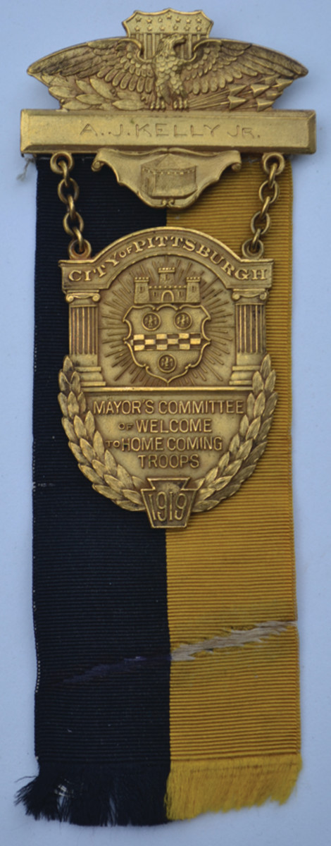 This WWI Pittsburgh Homecoming Medal made by Heeren Brothers is named to A.J. Kelly — someone who could not be verified as having served during WWI.