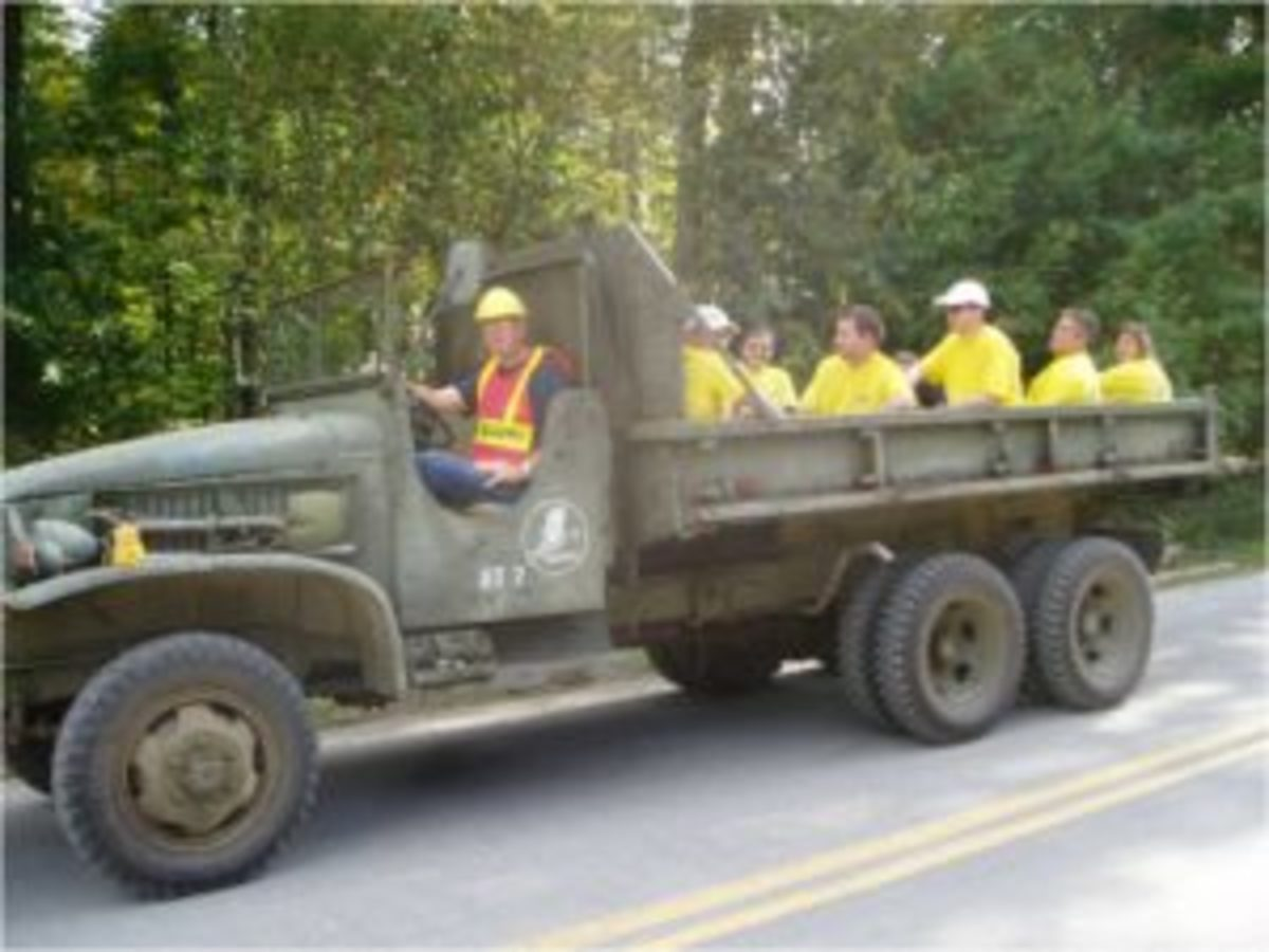 Bob Muller's CCKW is shown transporting one of the several groups of volunteers to one of the sites needing assistance. Volunteers piled the CCKW high with flood debris of all descriptions including boats, canoes, furniture, road signs, appliances and more.