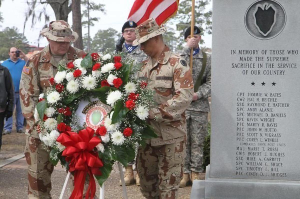 Gulf War Veterans lay wreath at 24th ID Desert Storm Memorial (PRNewsFoto/Veterans of the 24th Infantry)