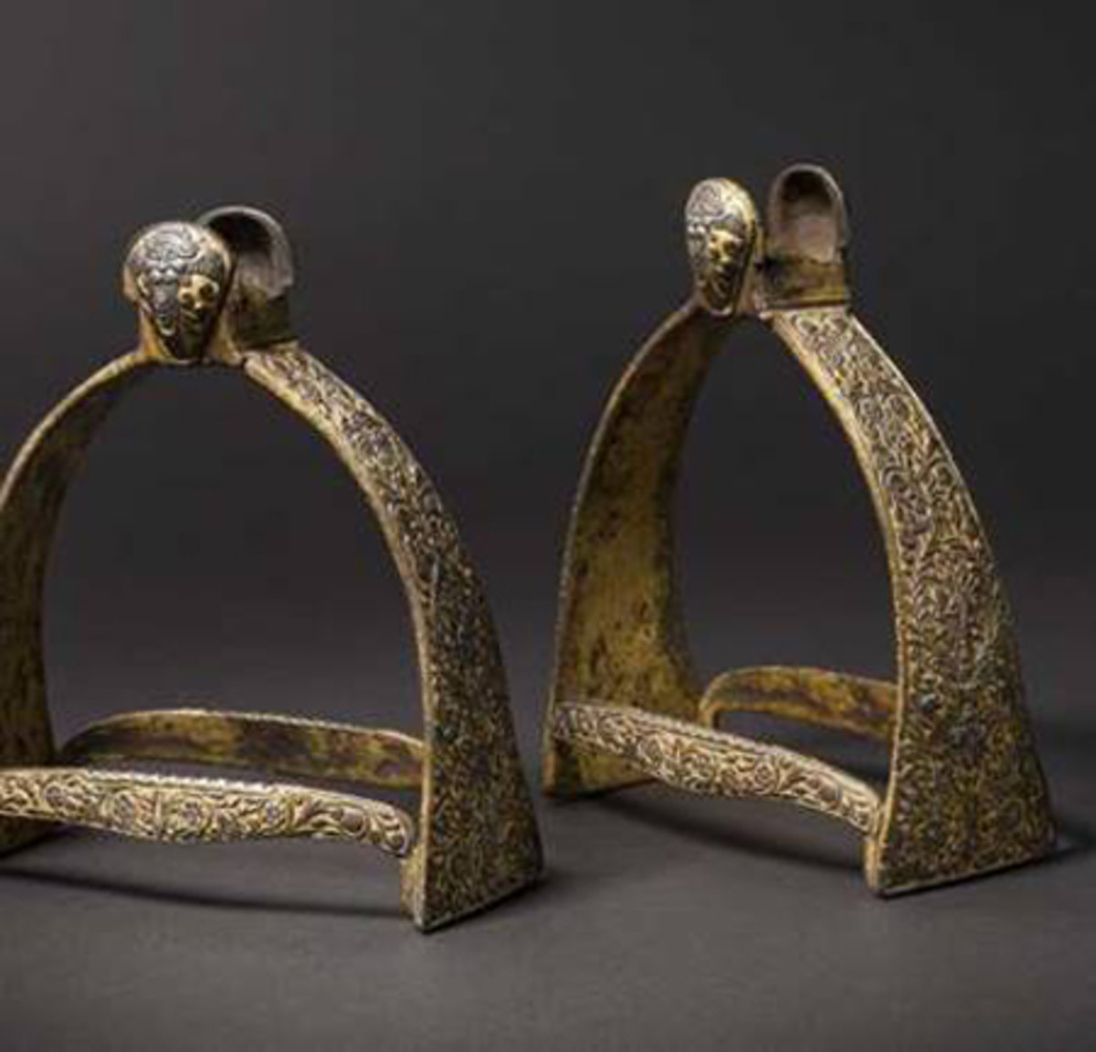 Chiselled and gilt stirrups by the celebrated Munich steel-chiseller, Caspar Spät, ca. 1650.