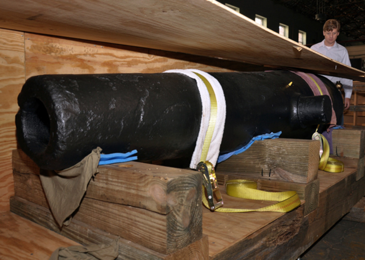 A 32-lb cannon recovered from the wreck of the Confederate sloop-of-war CSS Alabama is seen at the Naval History and Heritage Command laboratory warehouse. Alabama was built for the Confederate States Navy and served as a commerce raider, attacking Union merchant and naval ships during the Civil War. Alabama was sunk on June 19, 1864 during a battle with USS Kearsarge off the coast of France. (U.S. Navy photo by Mass Communication Specialist 2nd Class Kenneth G. Takada/Released)