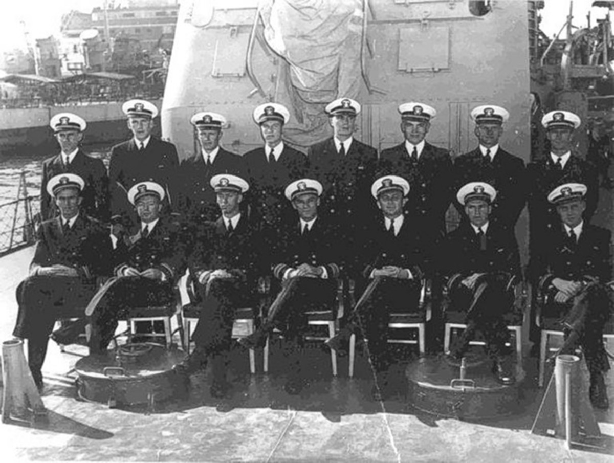 "USS Strong's officers pose for an official portrait on the day of the destroyer's commissioning. The commanding officer Cmdr. Wellings is in the center of the bottom row, with ship's executive officer Lt. Cmdr. Purdy immediately to his right. Lt. Hugh ""Rose Bowl"" Miller is to Purdy's right. (National Archives. Courtesy of Mr. Stephen Harding)"