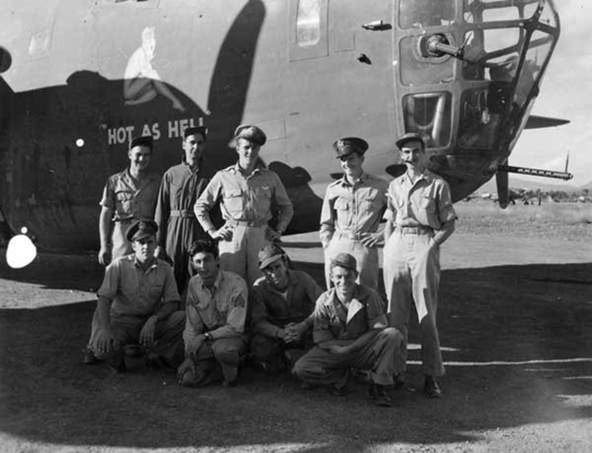 This plane, B-24J #42-73308, and its crew were assigned to the 308th Bombardment Group, 425th Bombardment Squadron. It was nicknamed 'Hot As Hell' with a seated woman on the right side of the nose. On January 24, 1944, the aircraft took off from Kunming Airfield in China on a routine flight to Chabua Airfield in India. It never returned. Its wreckage was discovered in 2006. Only the remains of Lt Oxford (standing, second from the right) have been recovered and identified.
