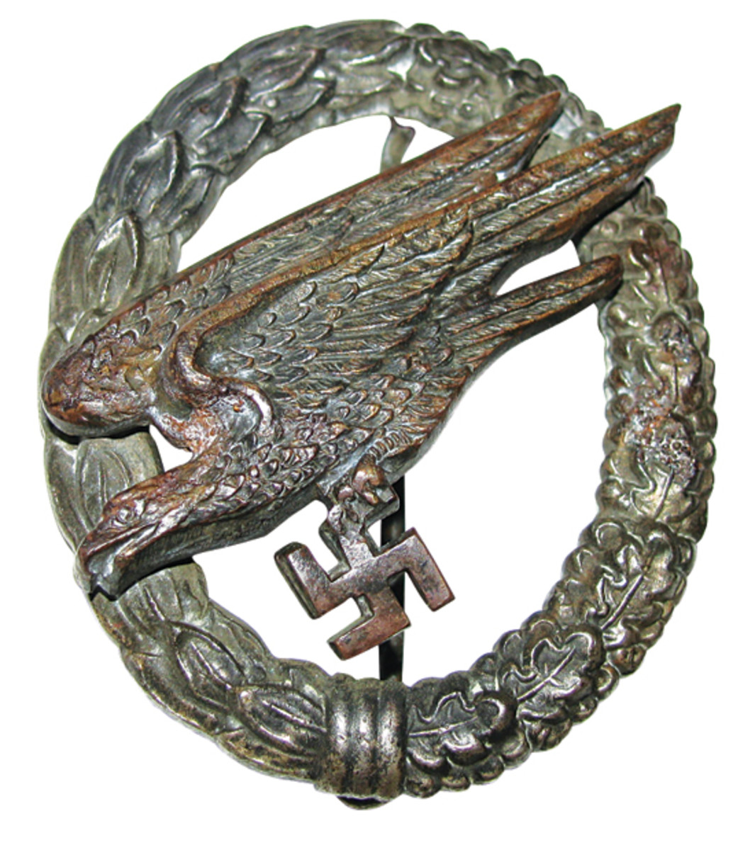 This well-worn paratrooper's badge shows signs of thinning plating on the wreath and eagle.
