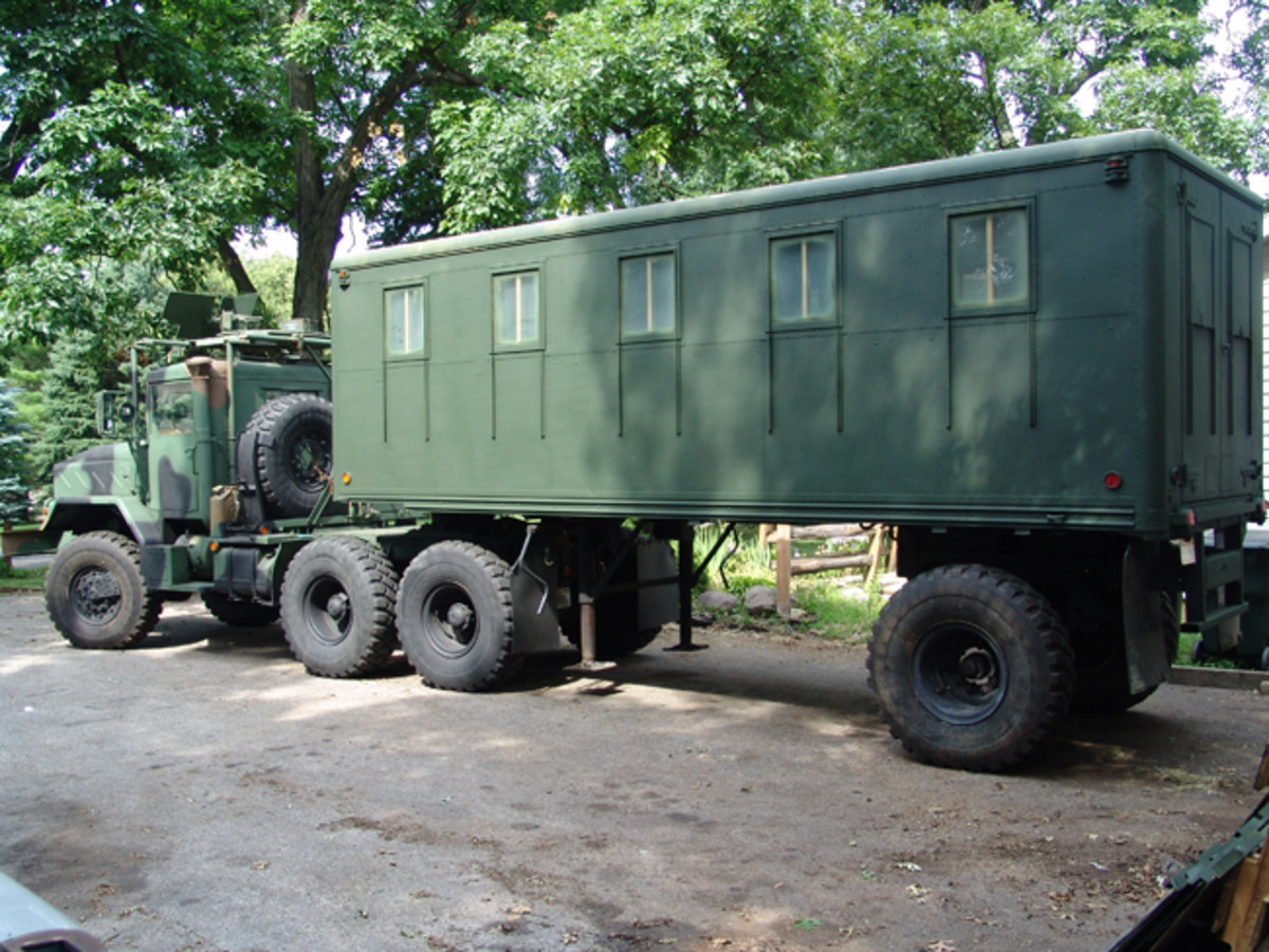 """Sporting September 1964 build tags, the M146 was a bit low to be pulled behind the M932A2. So, Chuck decided to """"level things off"""" by lifting the trailer with a second frame rail. He used custom 6-10 lug adapters so that he could run the same wheels on the trailer as on his M932A2."""