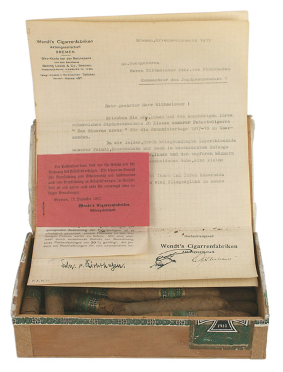 Christmas 1917 gift box of cigars sent to German World War I flying ace Baron von Richtofen, with a large Iron Cross on the lid and 16 of the original cigars still inside.