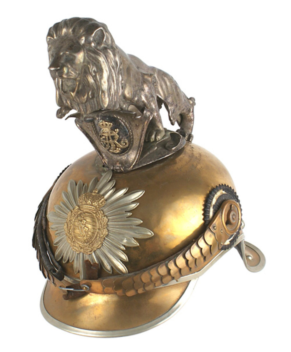 World War I-era presentation Saxon Garde Reiter regiment dress helmet with three-dimensional silvered lion mounted on a large oval silvered plate affixed to the top.
