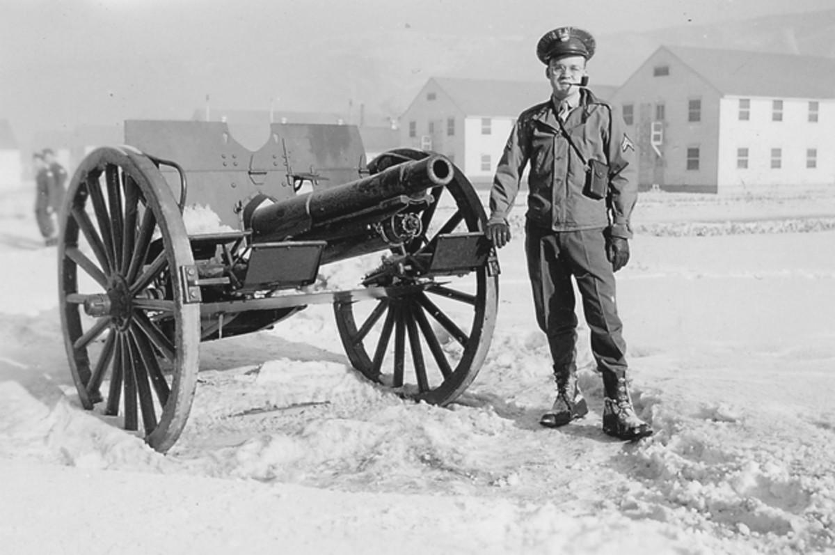 "Corporal John Graf with Camp Hale's 75mm ""salute"" gun."