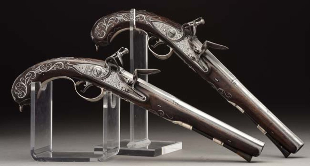 Archibald Montgomerie's pair of fine English silver-mounted flintlock pistols with belt hooks, by Bailes, 1760. Sold for $55,575
