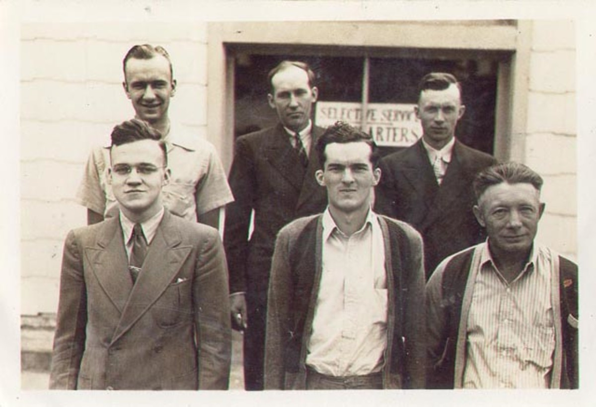 J.Milton Graf (first row, left) inducted into service by Henry Tiedtz, Caledonia, Minnesota, July 27, 1942.