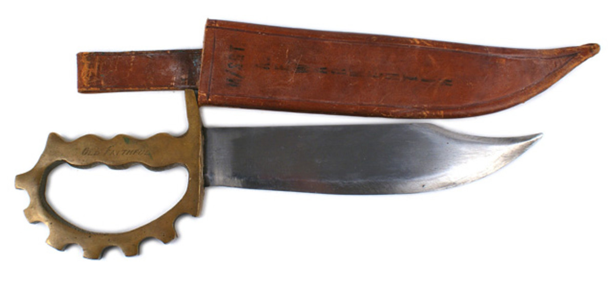 U.S. World War II 1st Ranger Battalion special combat knife with a 9 ¼ inch Bowie blade ($1,220).