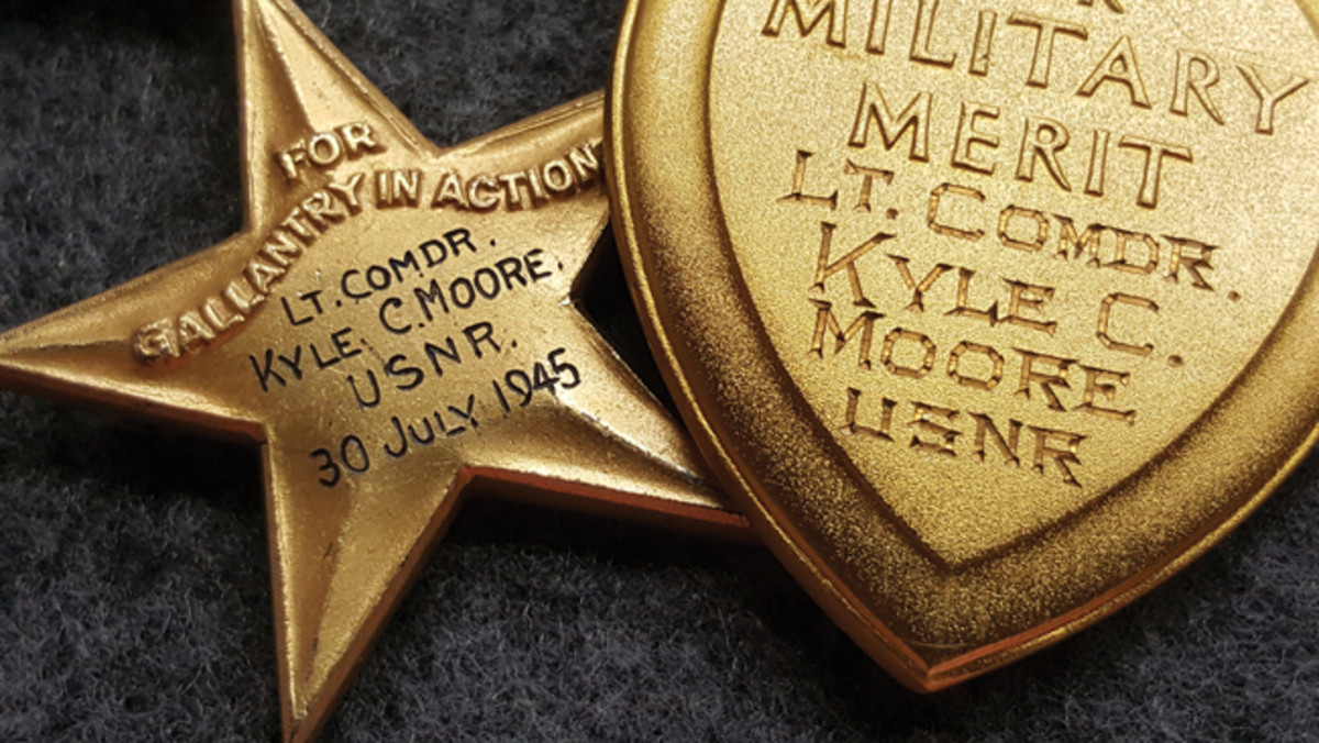 The reverse side of Kasey's engraved medals. The Silver Star has the date reflecting the final day and his last heroic stand on his ship.