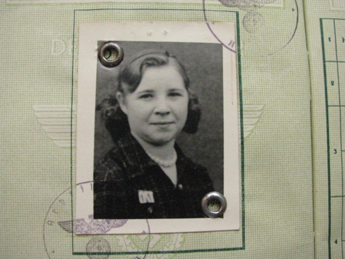 "This 19-year-old metal worker wears the ""OST"" patch in her Arbeitsbuch photo."