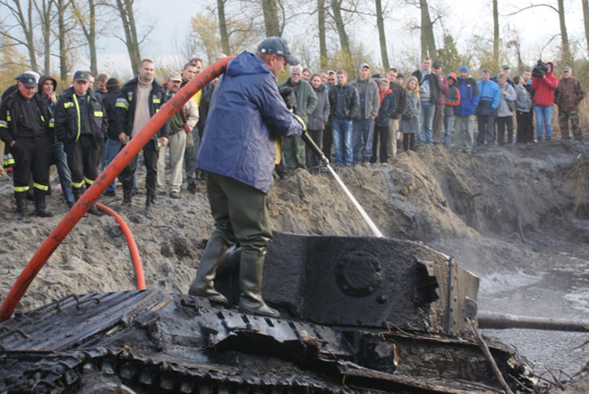 Crowds looked on as the Valentine was rescued from the muddy river. It is estimated that well-preserved tank could be made operational in as little as two years.