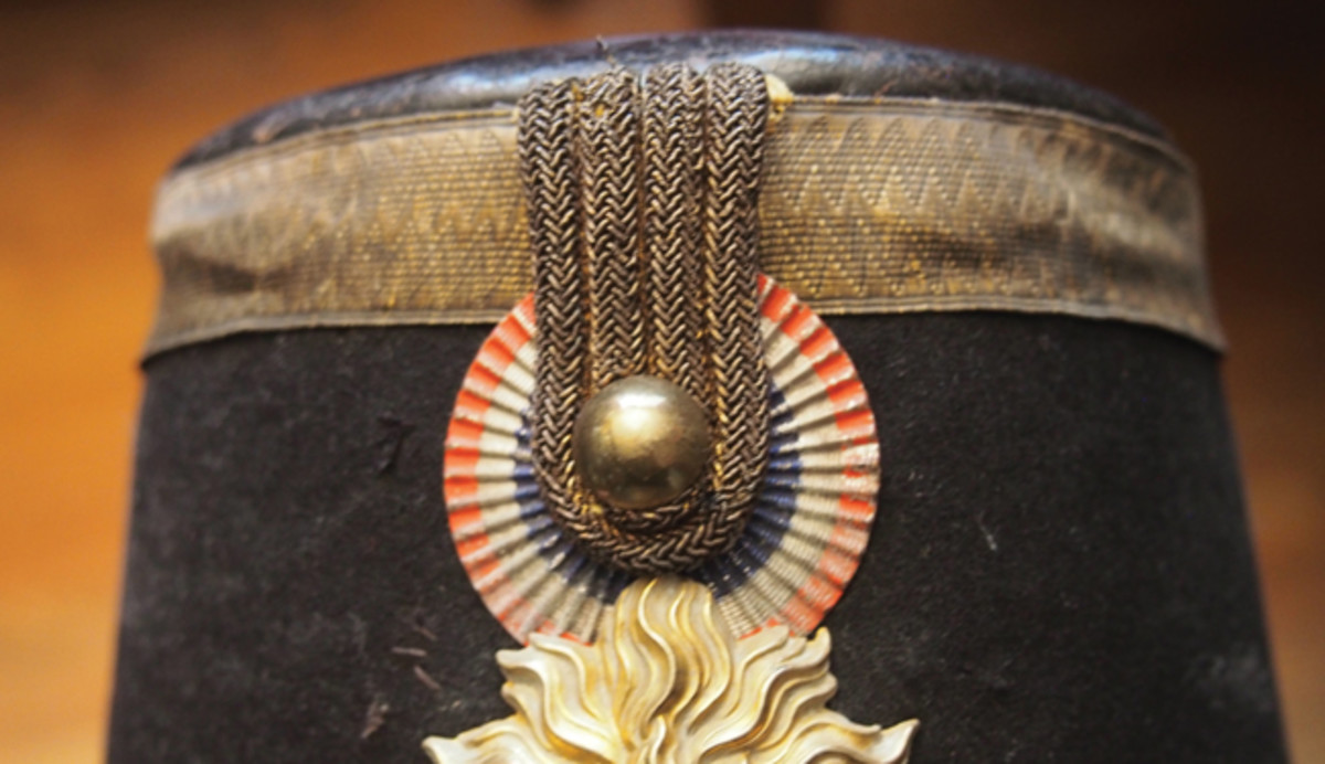 While the French may have been the first nation to widely use multi-colored cockades on its military headdress, the practice fell into disuse after the Franco-Prussian War. By the First World War, only a handful of units had cockades on their respective caps — usually only for ceremonial headdress. This is the last style French cockade as it appears on a Model 1872 Infantry Shako.