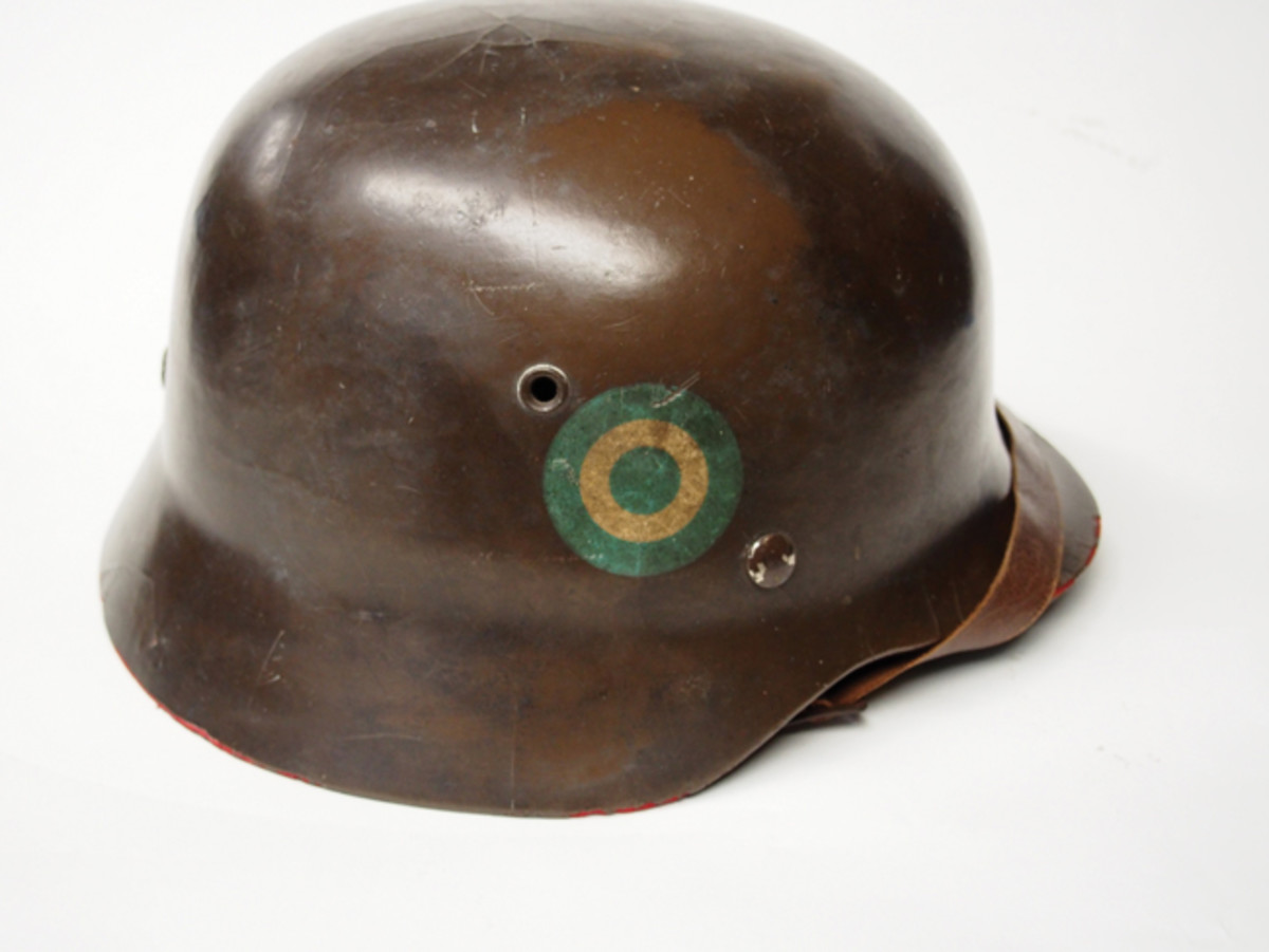 A German M35 parade style helmet featuring a stenciled Argentinean cockade. Even when painted as insignia on a helmet of this type, it is technically a cockade — not a roundel.