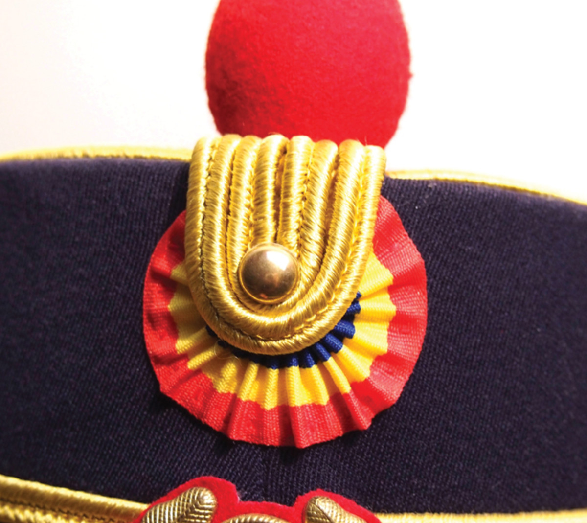 "Since the end of the Cold War former Soviet Bloc nations such as Romania have reverted to old traditions and this includes the use of more colorful guard units such as the Romanian army's 30th Honor Guard ""protocol/ceremonial"" Regiment – which wears a kepi with a red/yellow/blue cockade over the unit's insignia."