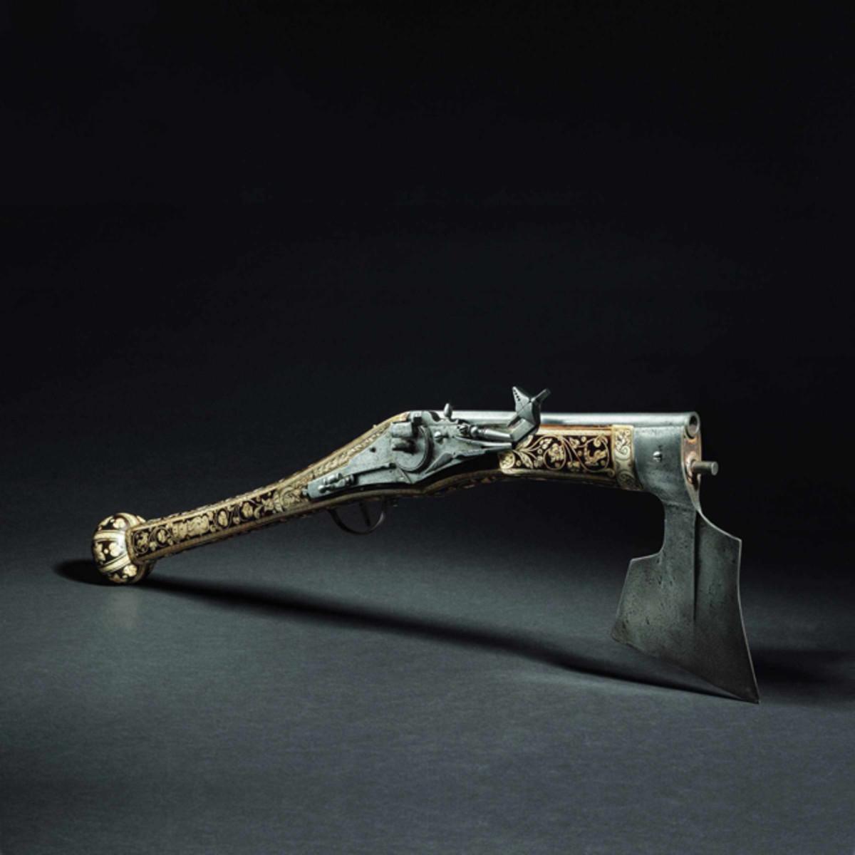 A battle axe with wheellock firearm, Nuremberg, circa 1580.