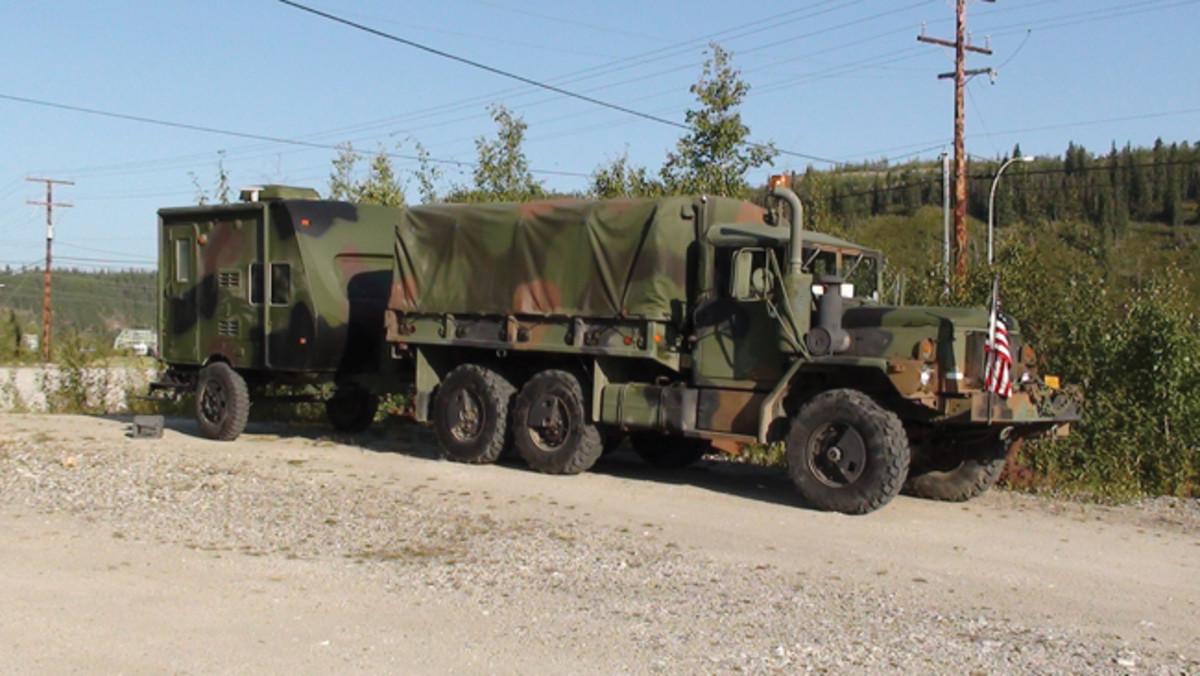 Mark and Gunnar Sigrist's M35A3 in the Yukon, Canada on the 2012 Alaska Highway Convoy. This truck was modified with lock out hubs, air passenger seat, FRS/GMRS radio, 100-gallon transfer tank in the cargo bed. The trailer is an M105A1 with axle narrowed and 13-foot Cruiser RV travel trailer mounted and painted to match. Mark has driven this truck more than 28,000 miles in the past 6 years