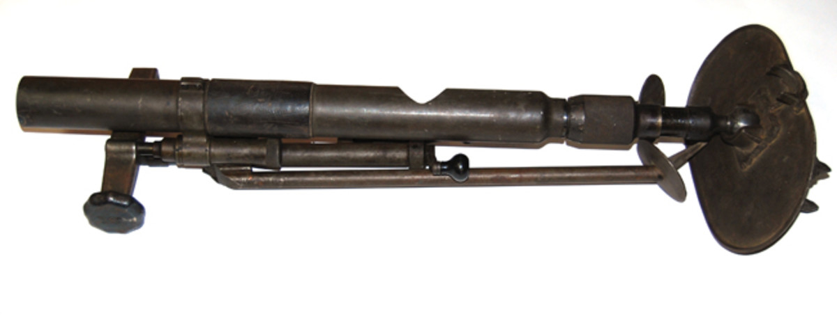 "A WWII-era Soviet 50mm mortar displays the hole cut in the tube. This is part of the ATF's description of what constitutes a ""deactivated mortar."""
