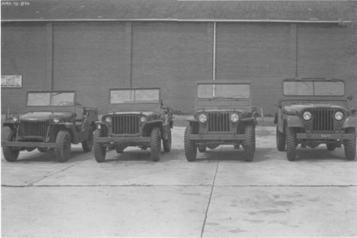 "Willys-Overland produced at least two Pilot Model ""Quads"" in 1940. The photo above was taken after 1952 based on the line up of military ""jeep"" models and includes a Willys-Overland Pilot Model Quad (far left). Anyone know where it is now? Buried in a Toledo garage perhaps? (PRNewsFoto/Historic Vehicle Association)"