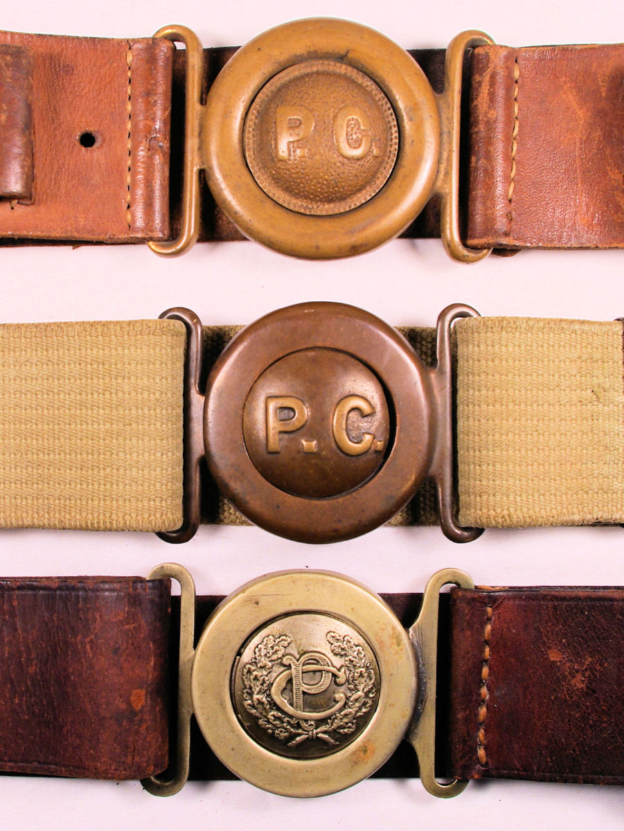 (TO TO BOTTOM) Shown together, the distinct differences of the Types 1, 2, and 3 belt buckles are obvious.