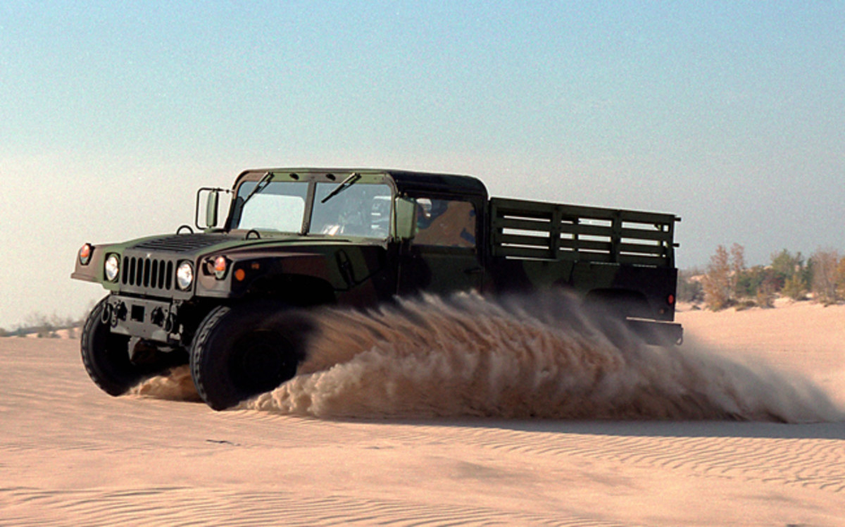 Humvee driving in the sand