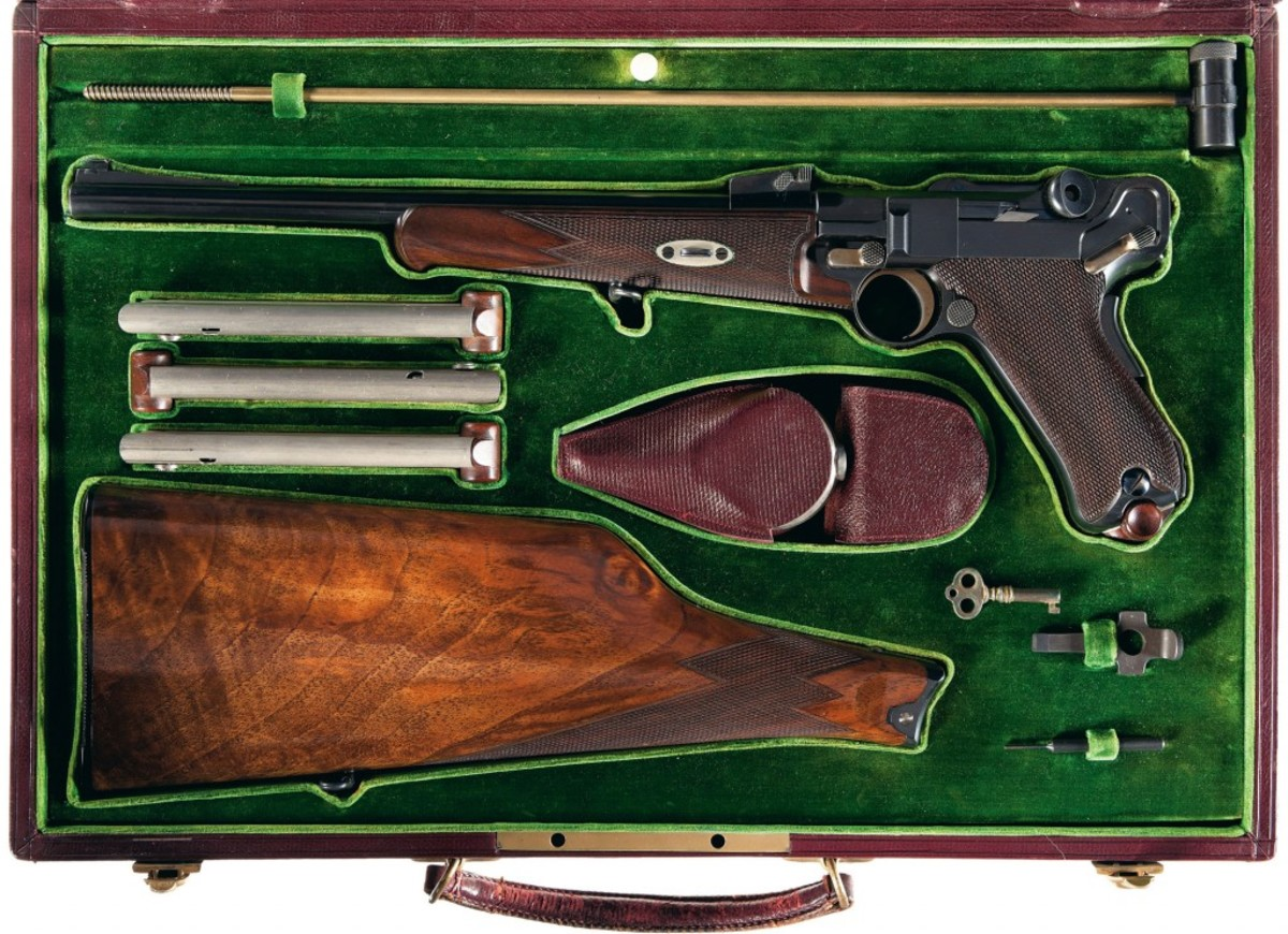 Lot 1571 - Cased Model 1902 Georg Luger DWM Semi-Automatic Carbine with Gold Inlaid Borchardt Presentation - $90,000-$140,000