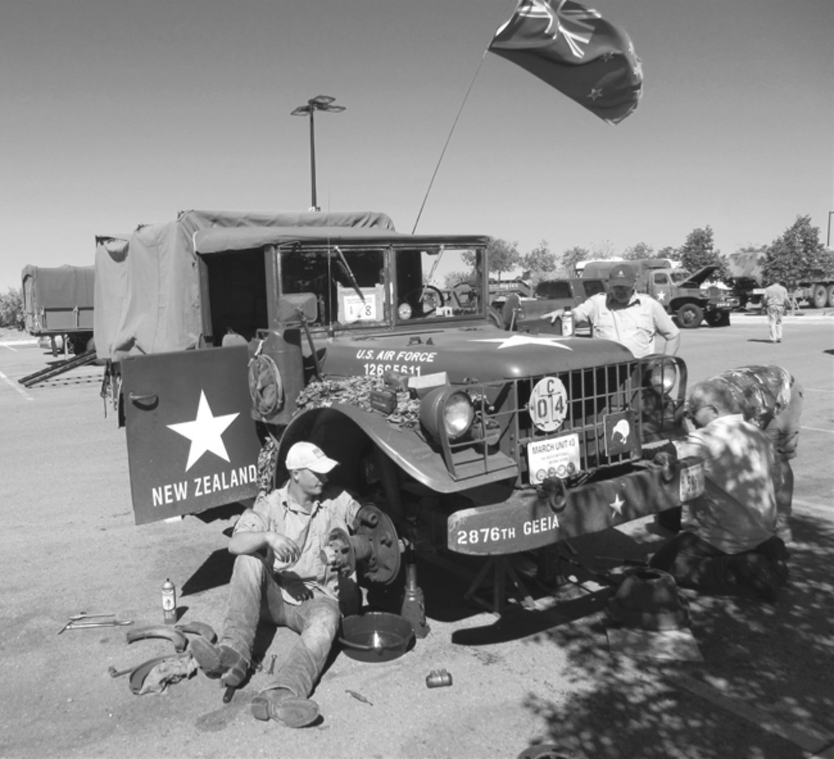 The attempt to find a shady spot to do a brake job on the New Zealander's M37 in Santa Fe Walmart parking lot was not very successful. HMVs in the background are undergoing PM motor stables on the Convoy's rest day. Mark Sigrist