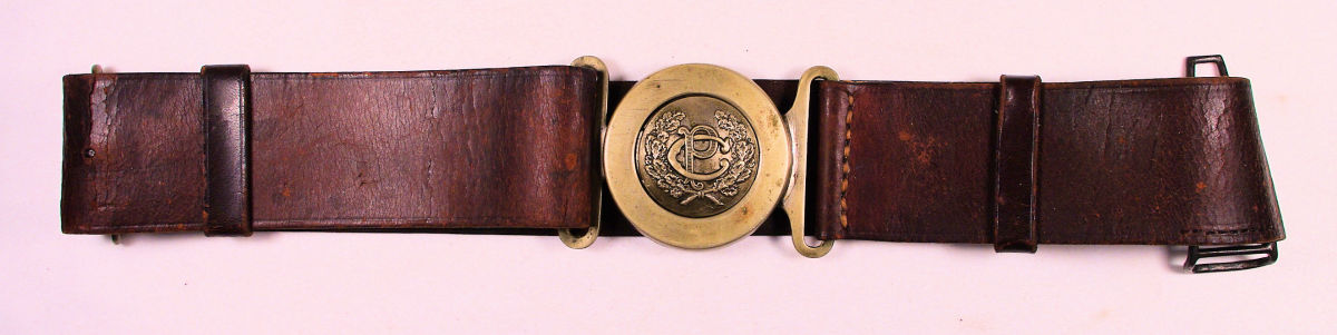 """The Type 3 PC officer's sword belt had a much more ornate tongue-and-wreath buckle. The """"PC"""" letters are very similar in style to those found on the emblem on the Constabulary sword scabbard"""