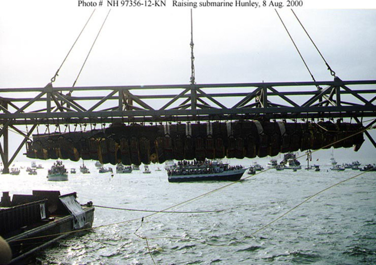 Confederate Submarine H.L. Hunley Suspended from its supporting truss, just after it was raised from the sea bottom off Charleston, South Carolina, on the morning of Aug. 8, 2000. U.S. Navy Photo by Barbara Voulgaris (RELEASED)