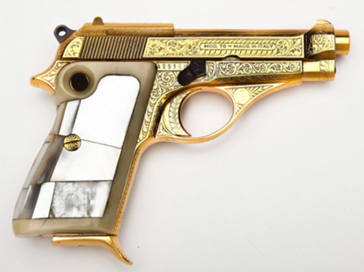 Beretta Gold Plated & Engraved Model 70 Pistol ($1,400).