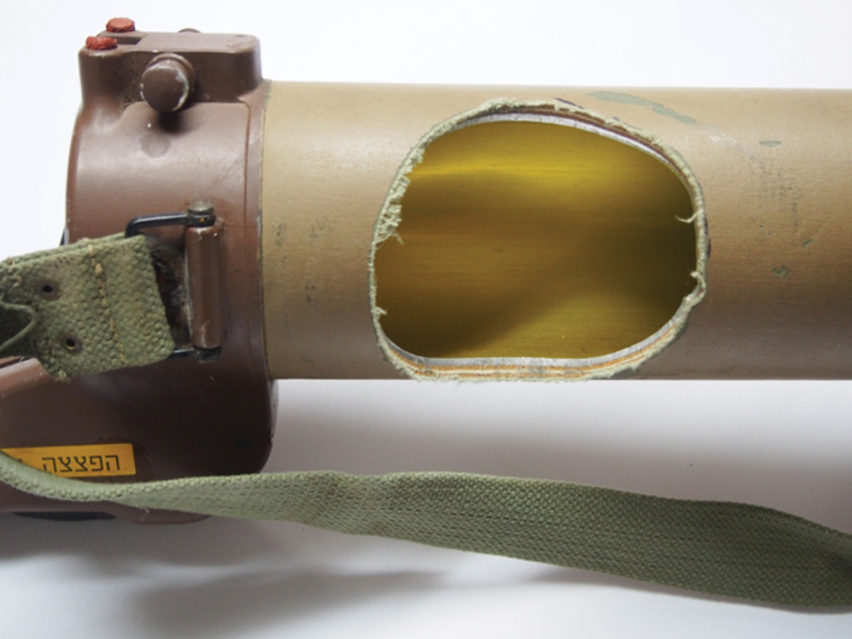 This close up shows a cut-out in an Israeli-used (Beligan-made) Blindecide anti-tank rocket. These were used in large numbers in the Six Day War of 1967. This weapon is made of fiberglass with a thin aluminum sleeve. Materials don't matter when it comes to destructive devices.