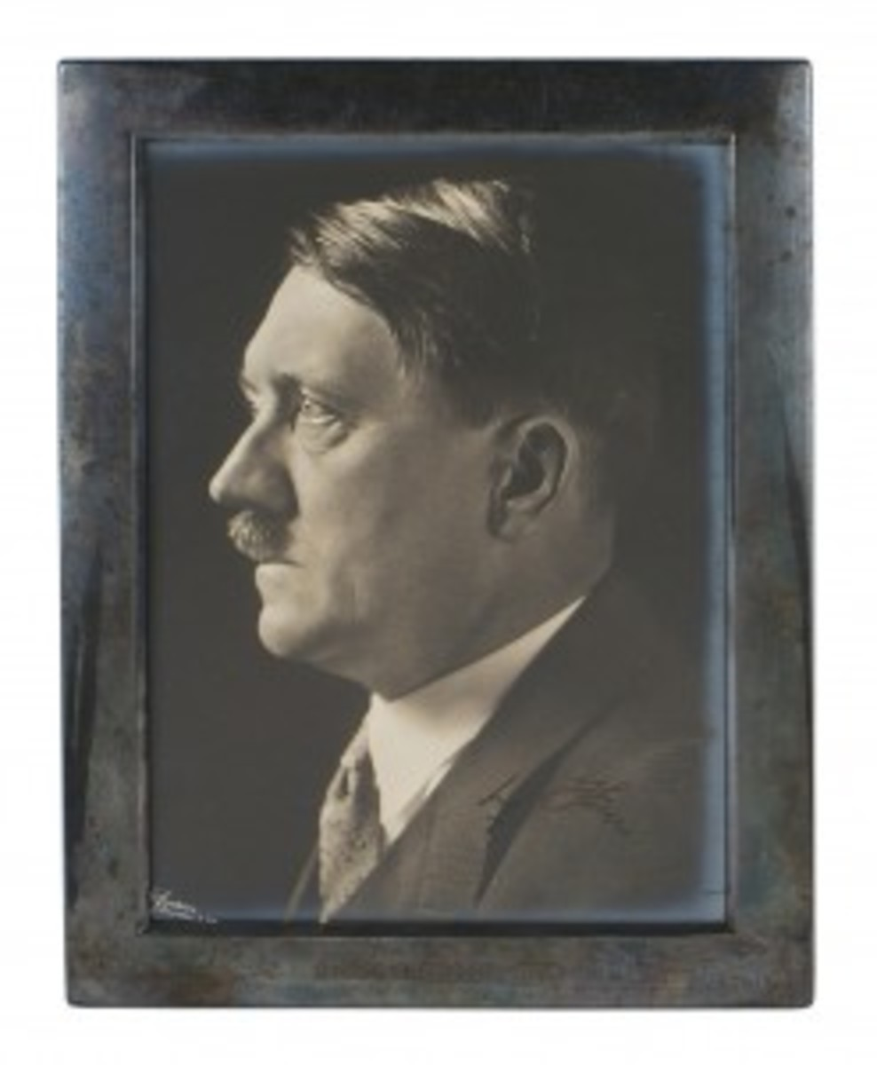 """The photo signed by Hitler was an autographed studio portrait, taken by the German leader's personal photographer, Heinrich Hoffmann. It showed a side profile of the subject wearing a civilian coat and tie. It was signed lower right in black ink, """"Adolf Hitler,"""" with no personalized message. The 8-1/2-inch by 10-3/4-inch photo was in a frame engraved """"1940."""" It sold for $3,840."""