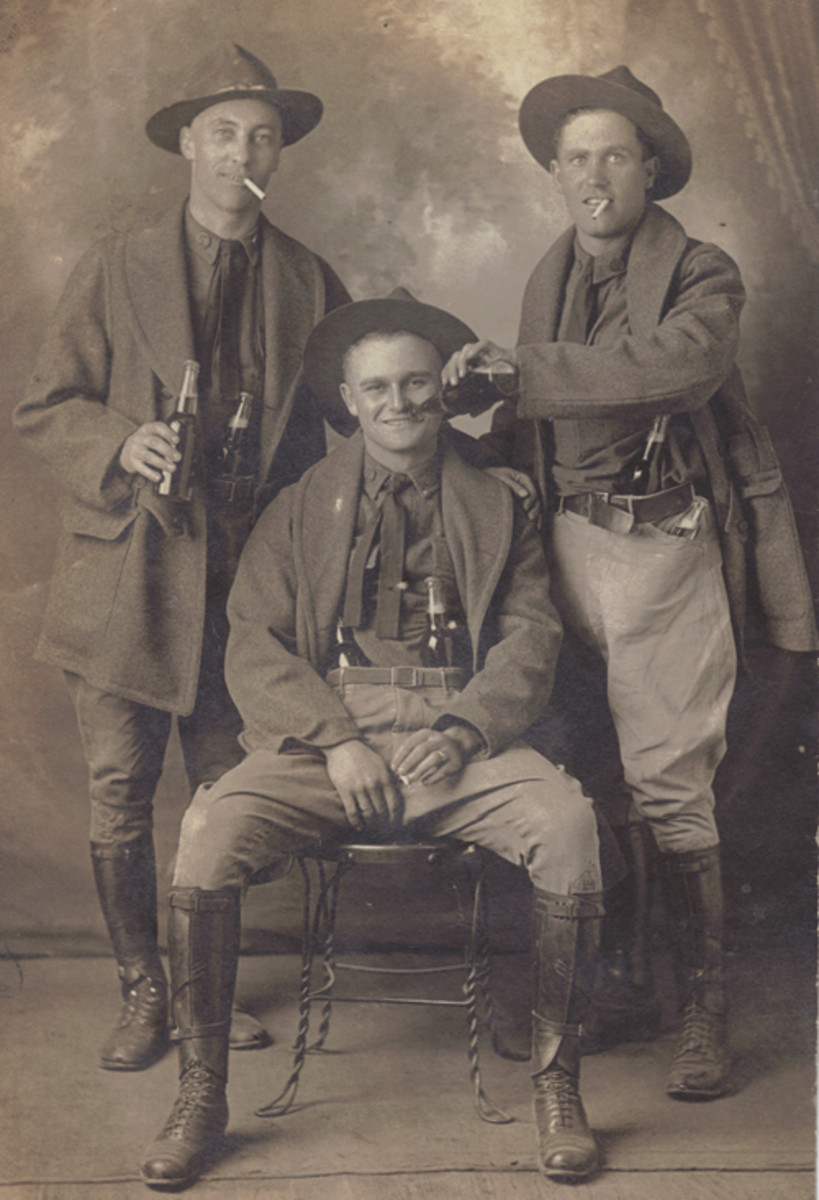 "An Interesting real photo postcard (RPPC) taken in San Antonio of three Doughboys from the 90th Division. Titled on the back ""That last night in San Antonia,"" these three soldiers have obviously decided to celebrate before leaving Camp Travis en route to France and their service in the AEF."