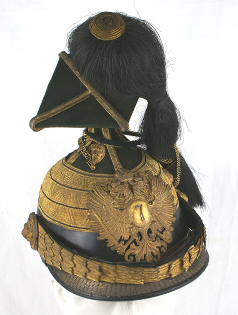 "Austrian model 1907 7th Uhlan Regiment Officer's ""tschapka"" (classic type helmet), with a patent leather body and dark green cloth extended skull ($3,300)."