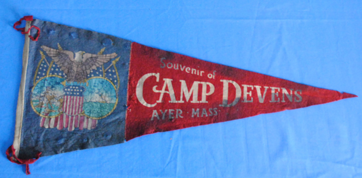 One of the more colorful, but harder to find in good condition, souvenirs purchased by the soldiers are the felt and cotton pennants made for units or training camps. This camp Devens example gives some hint of the original colors but has suffered a lot of damage over the years.