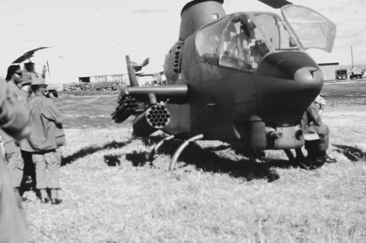 Closeup of Cobra gunship locked and loaded for area security for 1969 Bob Hope USO show at Long Binh, Viet Nam.
