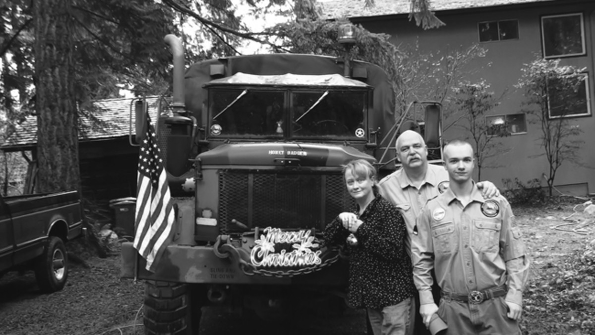 1993 AM General M35A3 posing for the 2012 Christmas Card following the MVPA Alaska Highway Convoy during which she traveled 7200 miles. Sundi, Mark and Gunnar Sigrist.