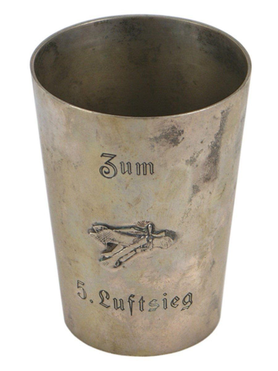 Silver victory cup of German World War I flying ace Lt. Hermann Frommherz, celebrating his fifth aerial victory (he had 32) over a Nieuport 28 ($1,650).