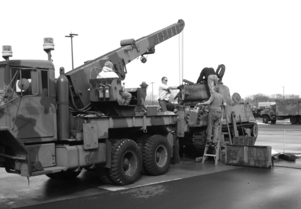 """The author's M816 Medium Wrecker being used to remove the engine from an M4 Sherman tank at the Fort Snelling Military Museum. This wrecker was used extensively at the museum for removing and installing """"packs"""" in a variety of tanks and for lifting and positioning heavy loads."""