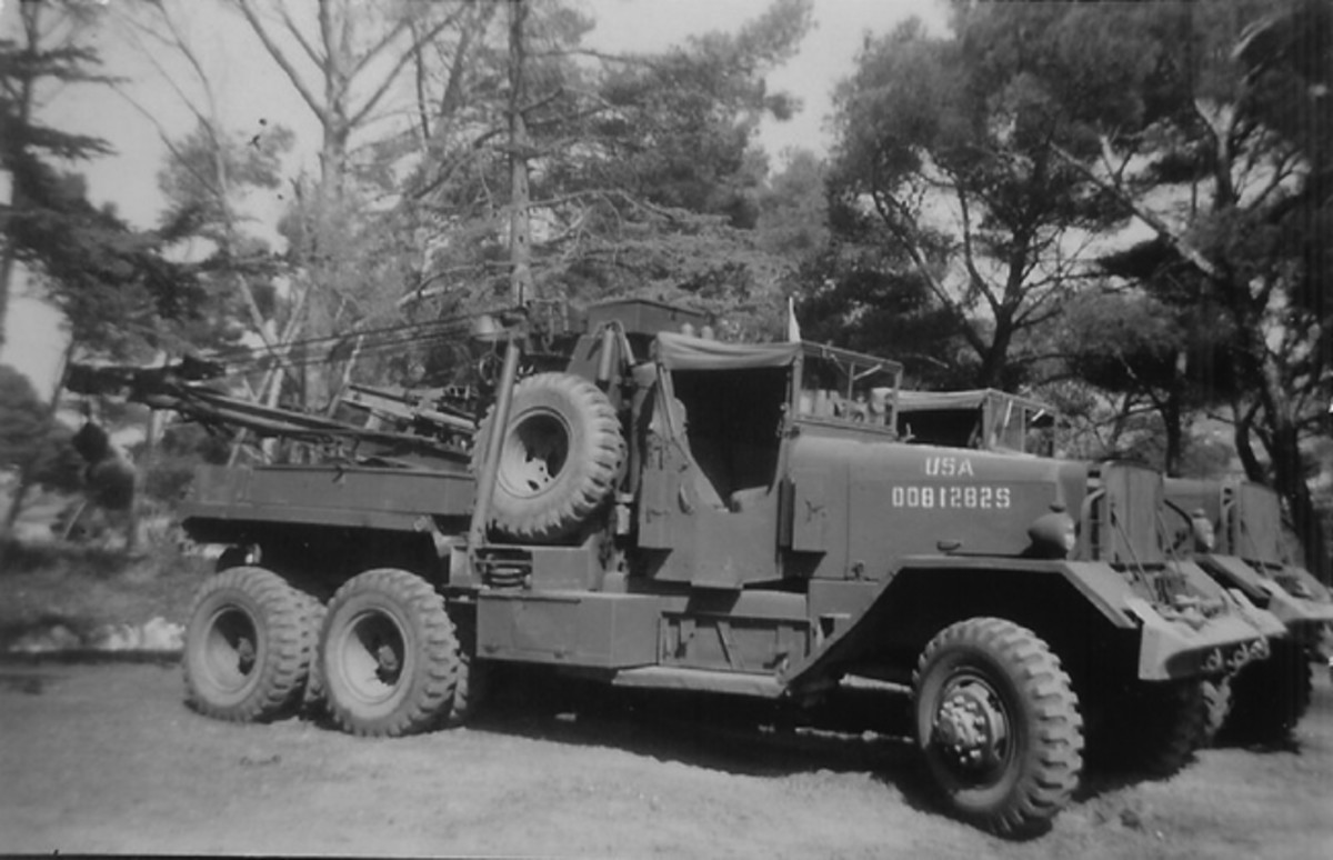 Two M1A1 Wreckers belonging to the 457th Ordnance Recovery Company in WWII. Note the open cab and the stabilizers behind the cab. These Wreckers supported recovery efforts conducted with the M26 Pacific and M15 trailer, and were used to remove roadblocks encountered in the area. The chisel-shaped front bumpers indicate that these were Series 5 trucks. (Photo courtesy 457th Reunion Assoc.)
