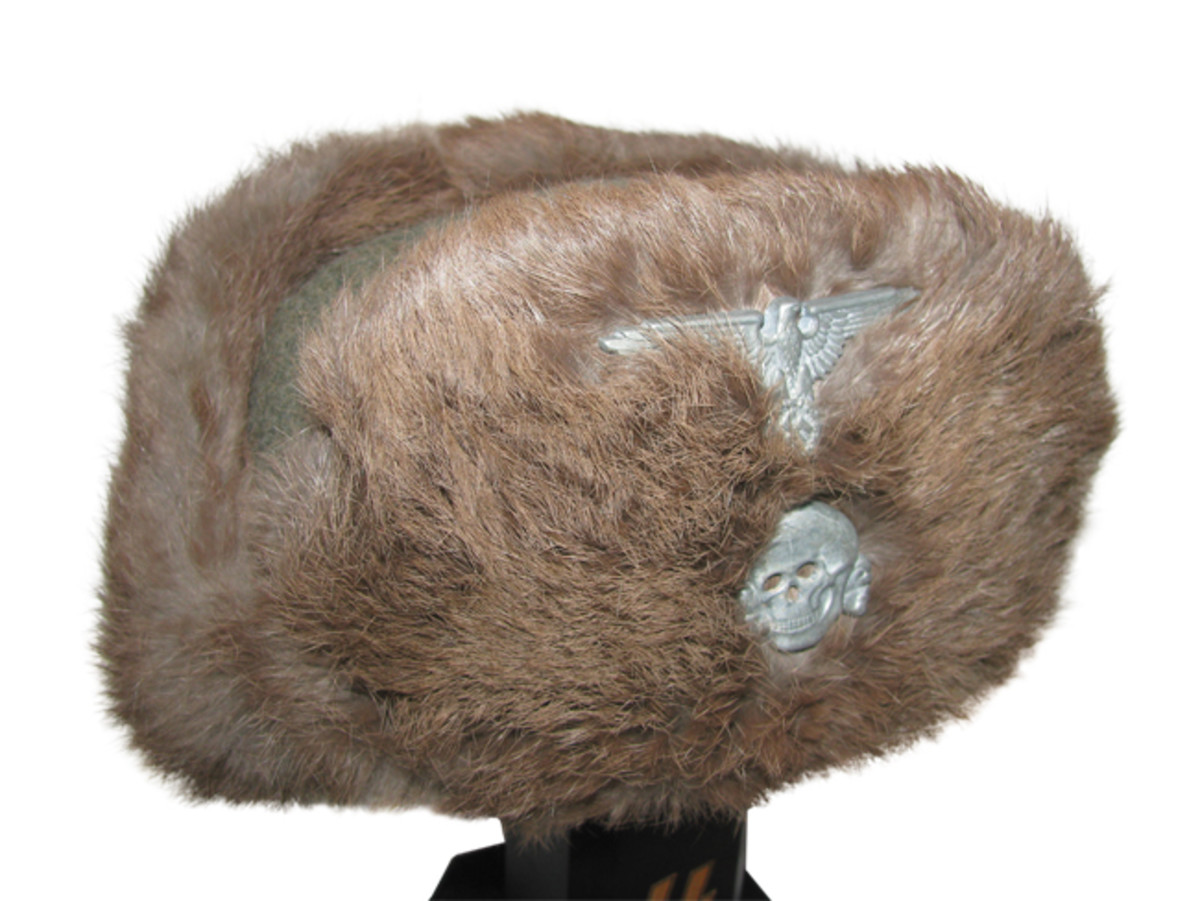 The Waffen SS winter cap consisted of wool and rabbit fur. Insignia consisted of the SS eagle and skull on the front. Mark Pulaski Collection