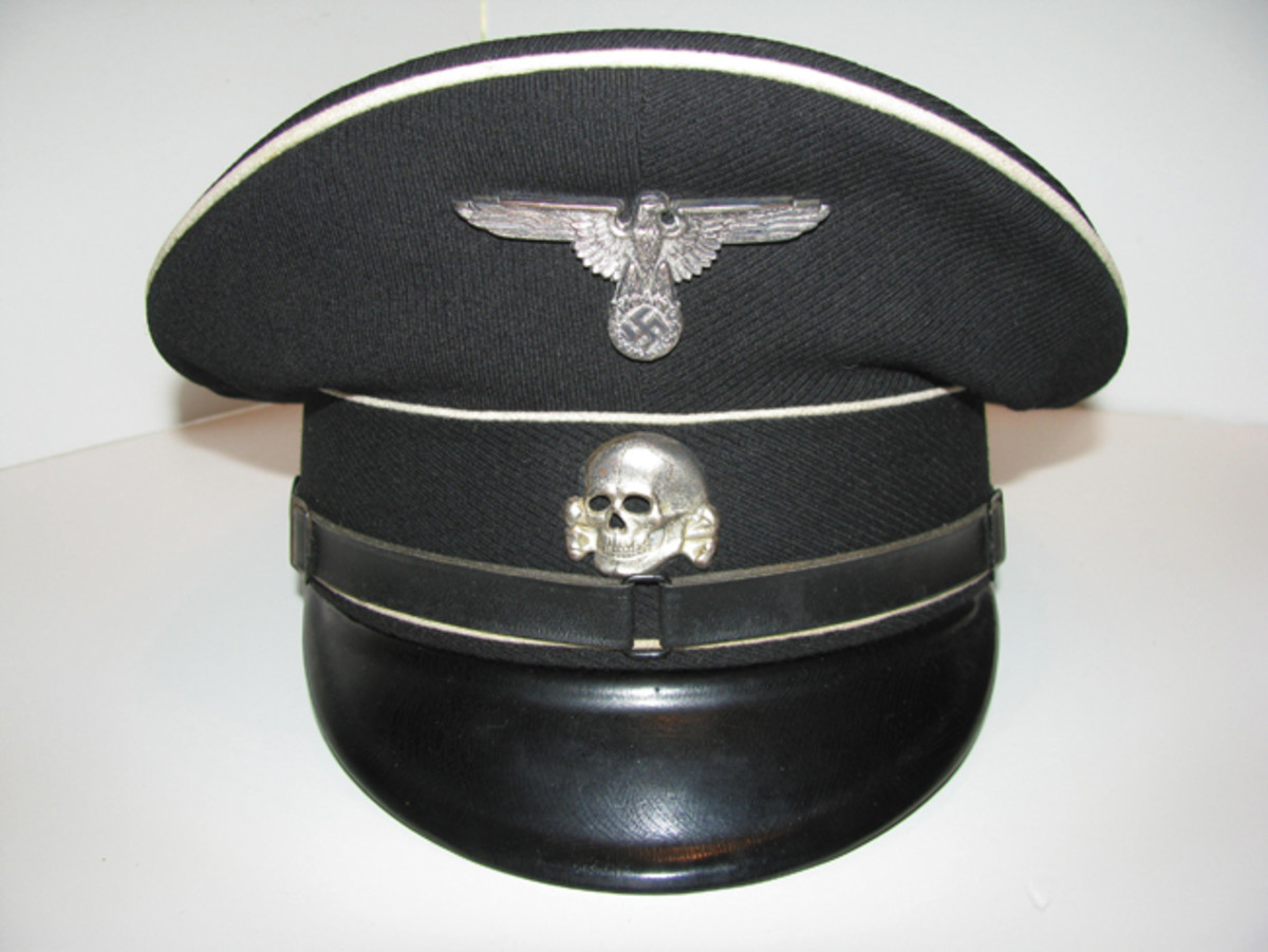 Hitler's elite members of the Allgemeine SS wore austere, black and white visor caps to incite feelings of pride, discipline, and fear. Mark Pulaski Collection