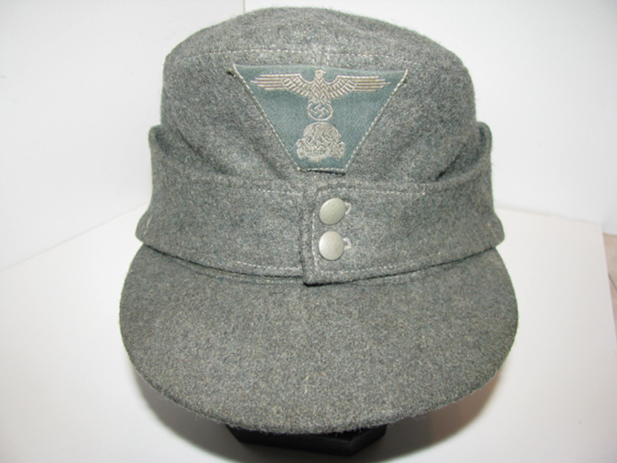 With a long visor and functional ear flap, the Waffen SS enlisted man's M-43 provided a functional alternative to prior service caps. Mark Pulaski Collection